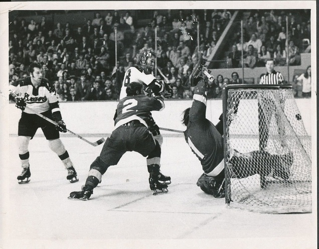 Don Marcotte, on an AHL conditioning stint with the Boston Braves, scores his first Braves goal vs. Tidewater and goalie Andy Brown.  Dec 14, 1971 (Ray Lussier)